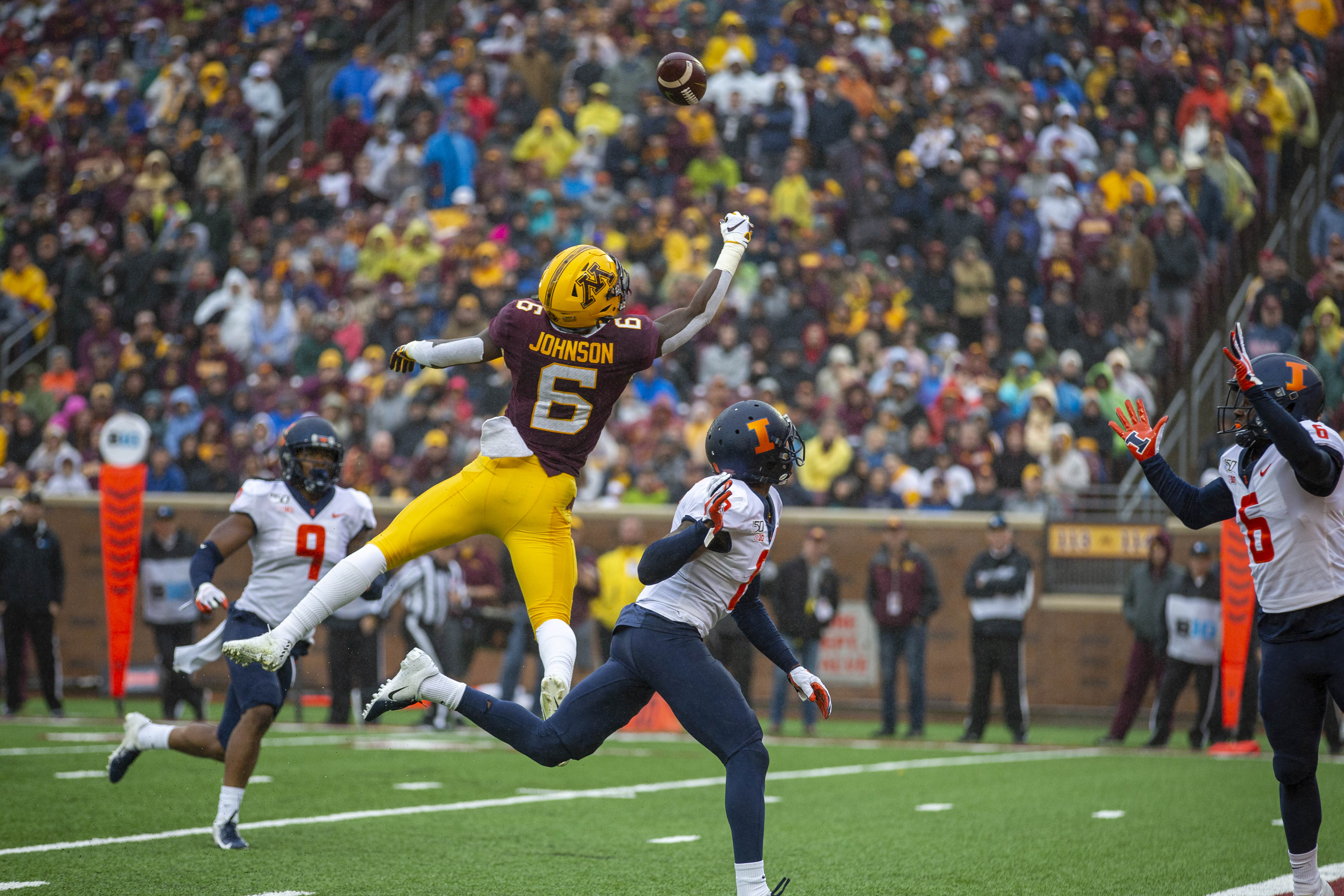 Oct 5, 2019; Minneapolis, MN, USA; Minnesota Golden Gophers running back Rodney Smith (1) rushes with the ball as Illinois Fighting Illini defensive back Jartavius Martin (21) and defensive back Tony Adams (6) attempt to make a tackle in the first half at TCF Bank Stadium. Mandatory Credit: Jesse Johnson-USA TODAY Sports