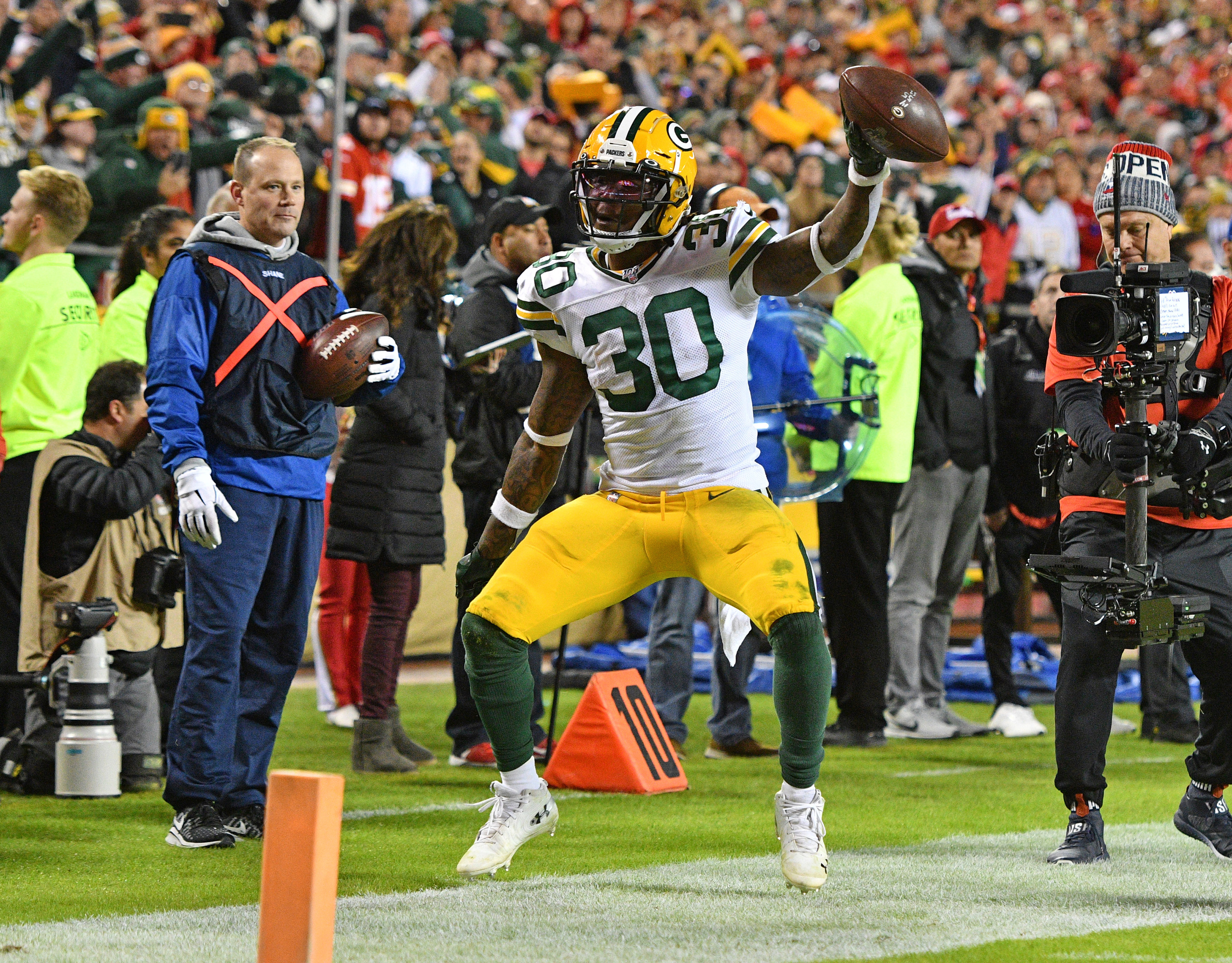 Oct 27, 2019; Kansas City, MO, USA; Green Bay Packers running back Jamaal Williams (30) celebrates after scoring during the second half against the Kansas City Chiefs at Arrowhead Stadium. Mandatory Credit: Denny Medley-USA TODAY Sports