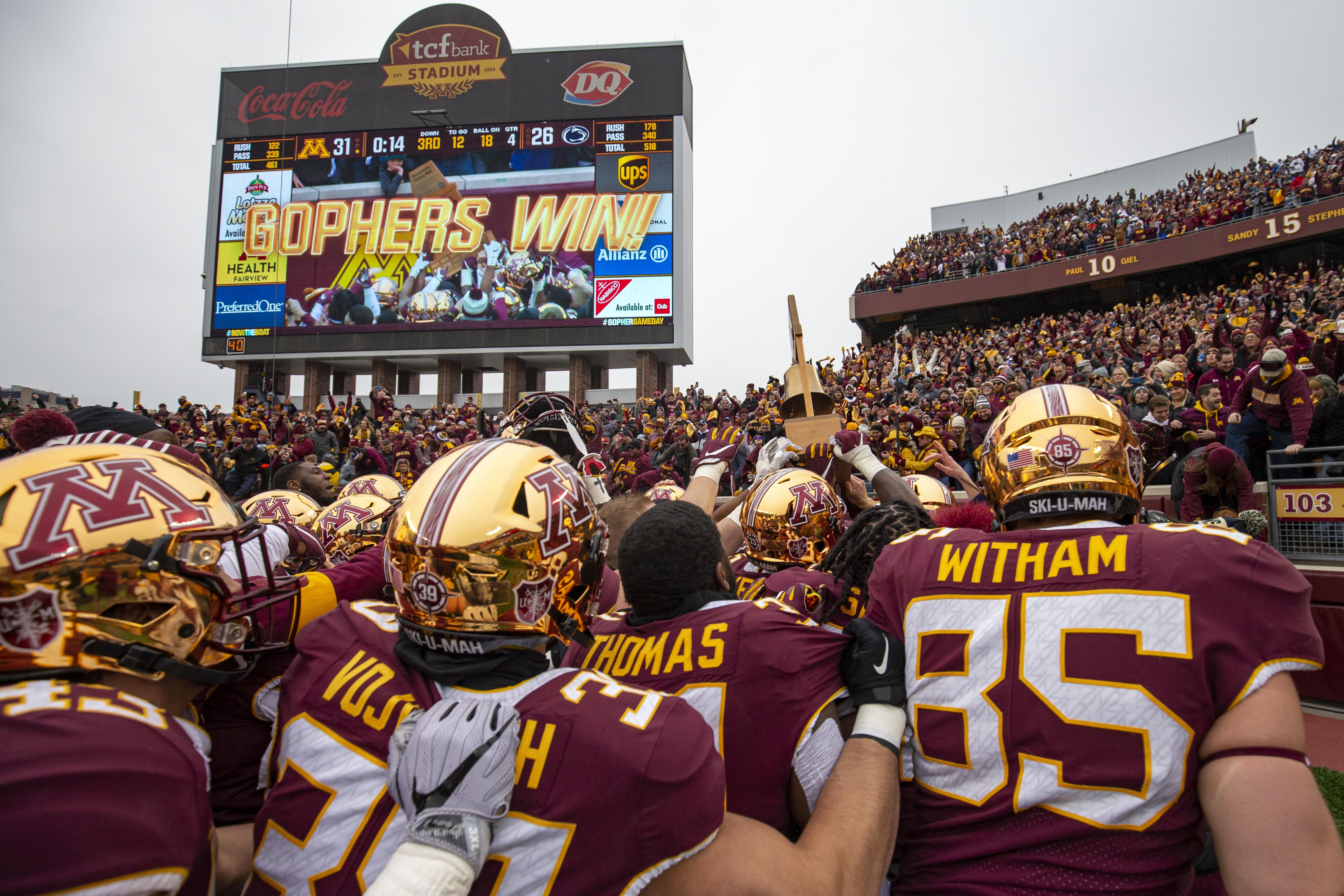 Nov 9, 2019; Minneapolis, MN, USA; Minnesota Golden Gophers team holds up the Governor Liberty Bell trophy after defeating the Penn State Nittany Lions at TCF Bank Stadium. Mandatory Credit: Jesse Johnson-USA TODAY Sports