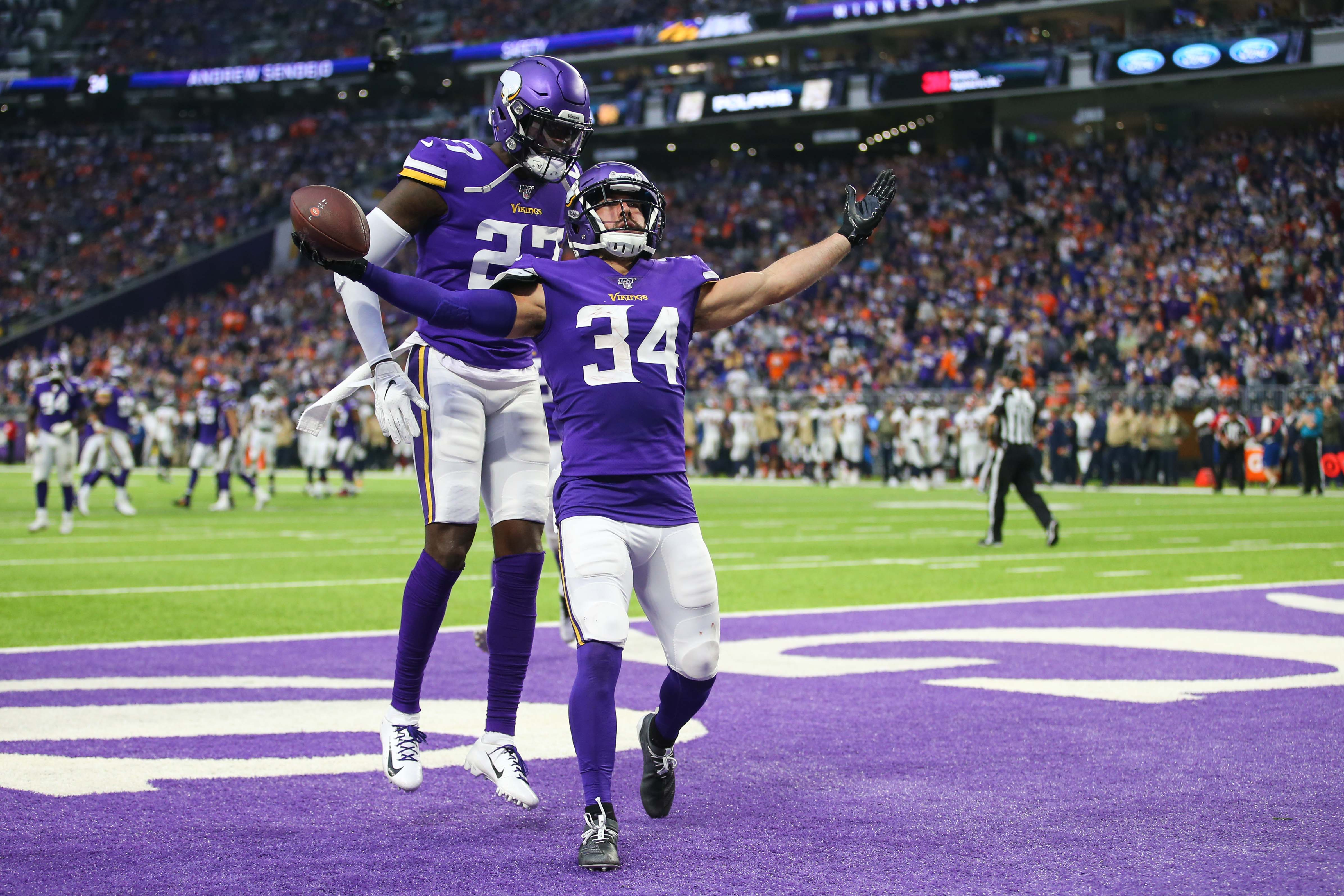 Nov 17, 2019; Minneapolis, MN, USA; Minnesota Vikings defensive back Andrew Sendejo (34) celebrates with defensive back Jayron Kearse (27) after intercepting a pass against the Denver Broncos during the second quarter at U.S. Bank Stadium. Mandatory Credit: Ben Ludeman-USA TODAY Sports