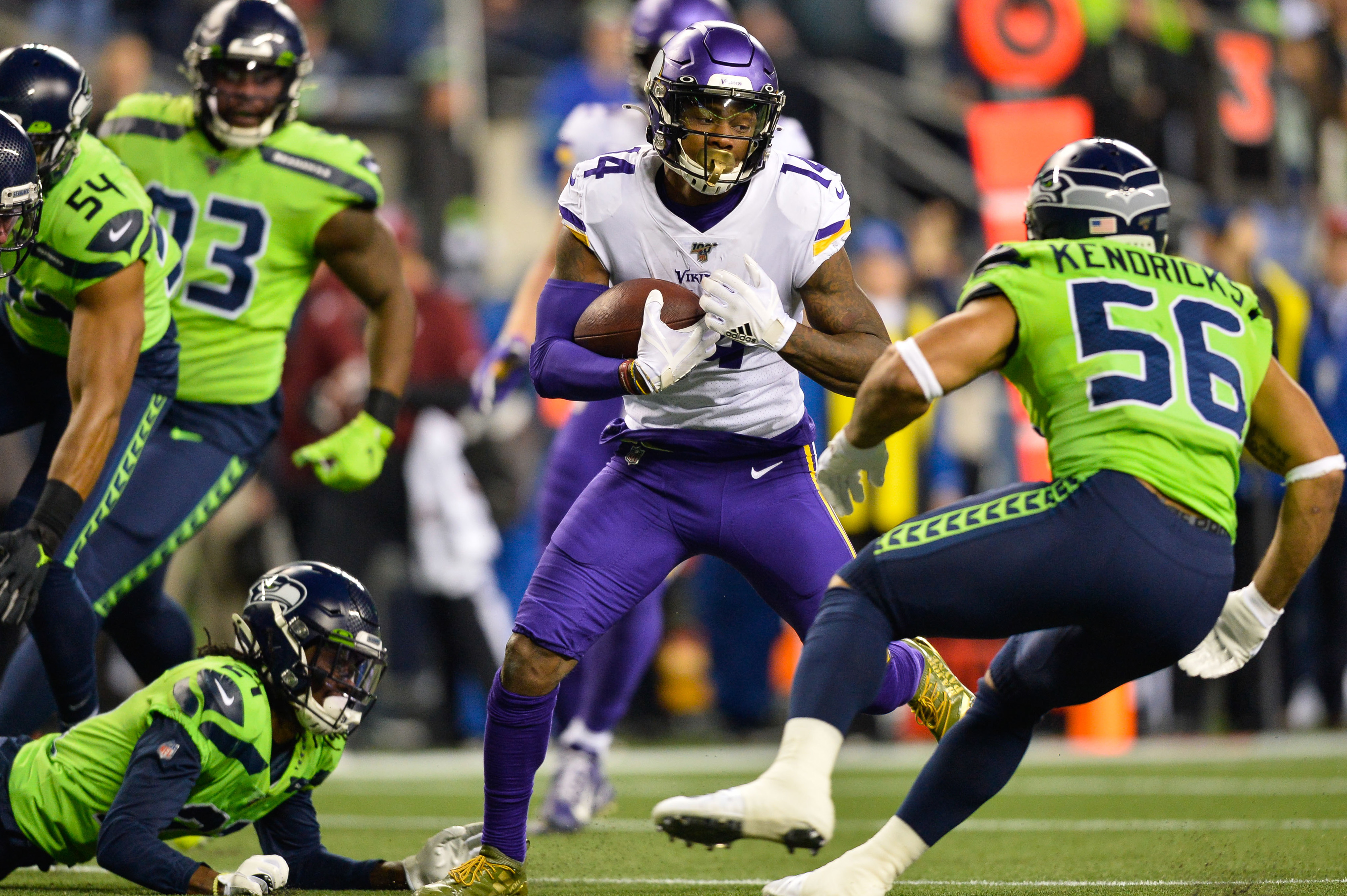 Dec 2, 2019; Seattle, WA, USA; Minnesota Vikings wide receiver Stefon Diggs (14) carries the ball after a catch against the  Seattle Seahawks during the first half at CenturyLink Field. Mandatory Credit: Steven Bisig-USA TODAY Sports