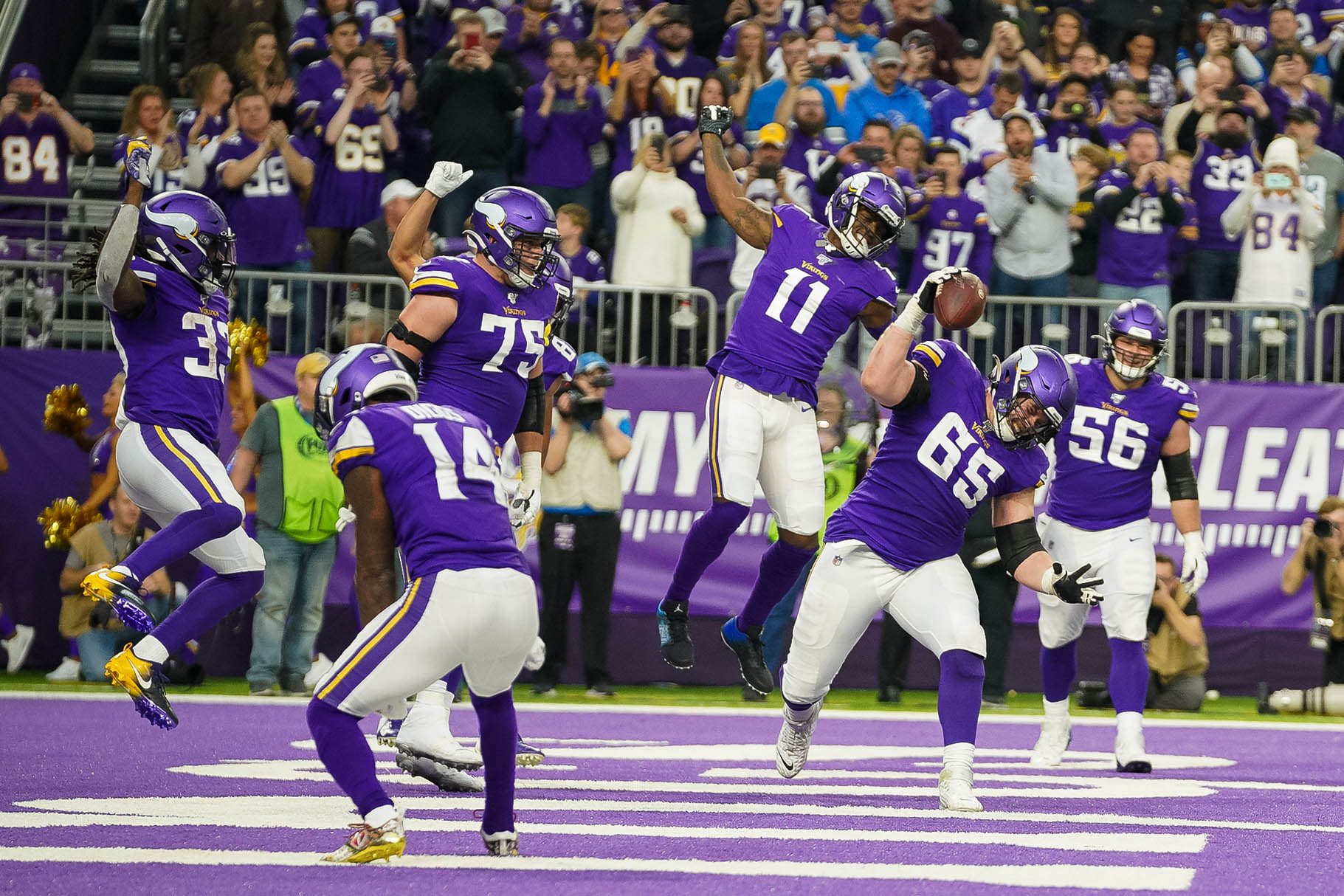 Dec 8, 2019; Minneapolis, MN, USA; Minnesota Vikings offensive lineman Pat Elflein (65) celebrates running back Dalvin Cook (33) touchdown in the second quarter against Detroit Lions at U.S. Bank Stadium. Mandatory Credit: Brad Rempel-USA TODAY Sports