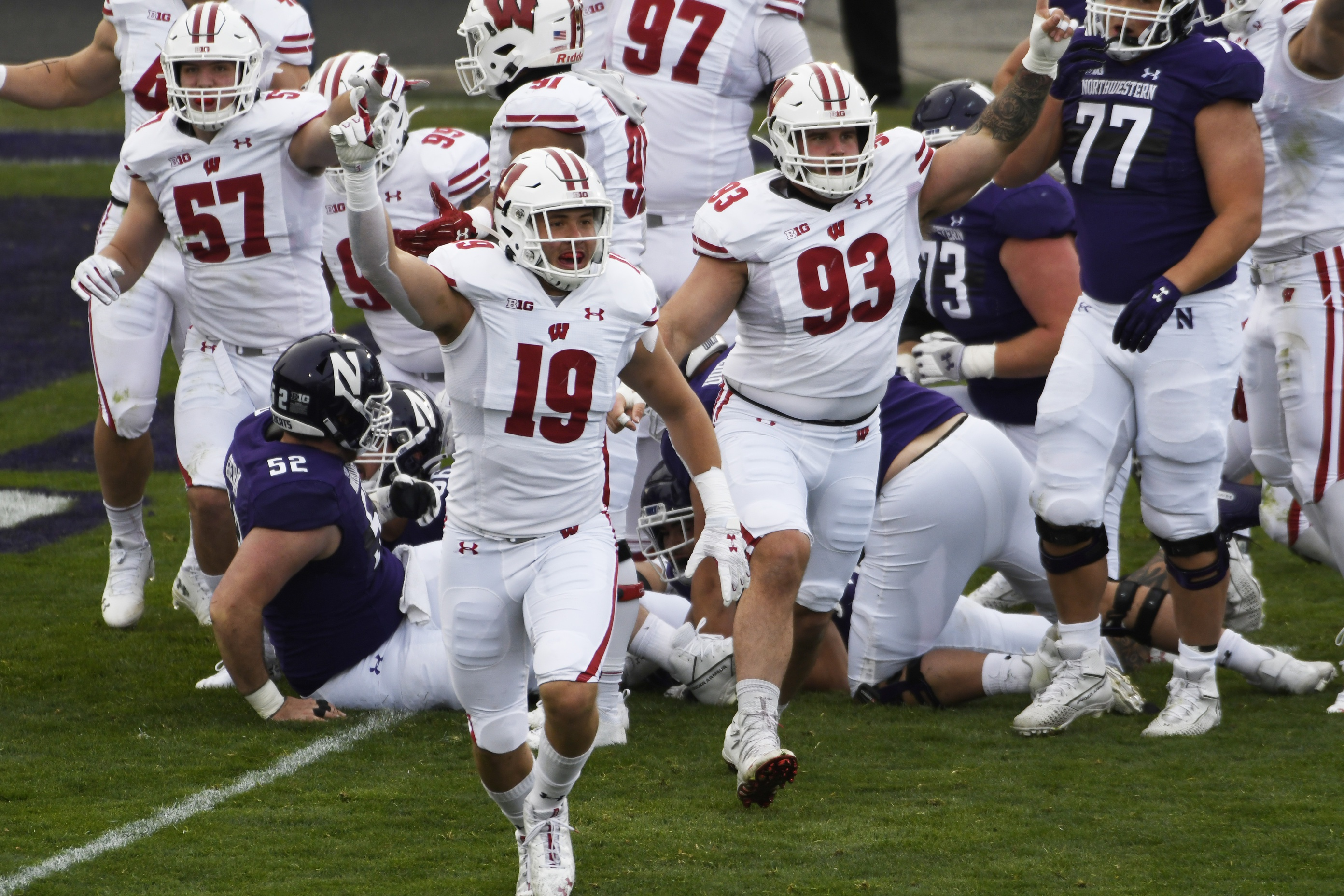 Nov 21, 2020; Evanston, Illinois, USA; Wisconsin Badgers linebacker Nick Herbig (19) celebrates his team's fumble recovery against the Northwestern Wildcats during the first half at Ryan Field. Mandatory Credit: David Banks-USA TODAY Sports
