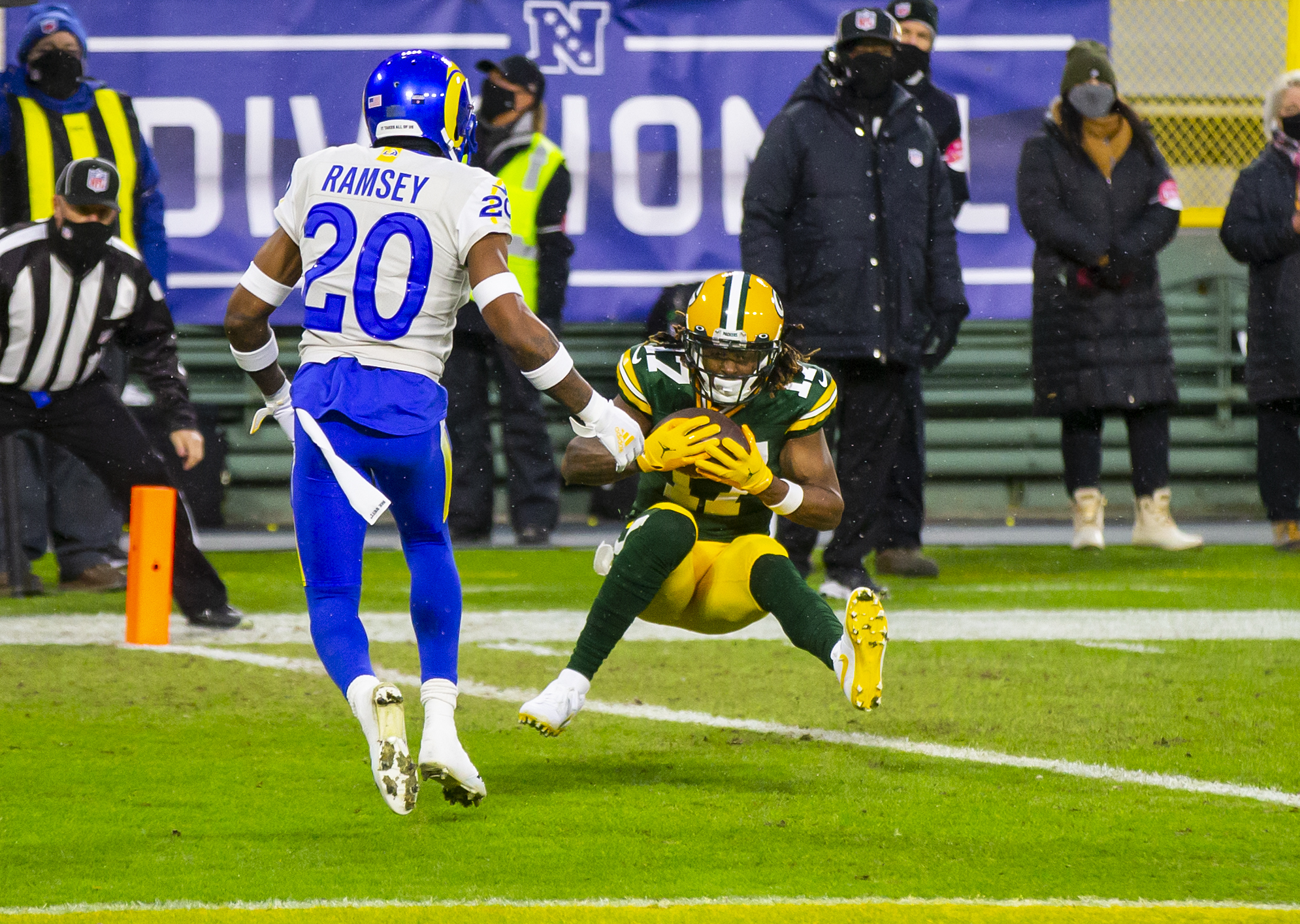 Jan 16, 2021; Green Bay, Wisconsin, USA; Green Bay Packers wide receiver Davante Adams (17) catches a touchdown pass against Los Angeles Rams cornerback Jalen Ramsey (20) in the first half of the NFC Divisional Round at Lambeau Field. Mandatory Credit: Mark J. Rebilas-USA TODAY Sports