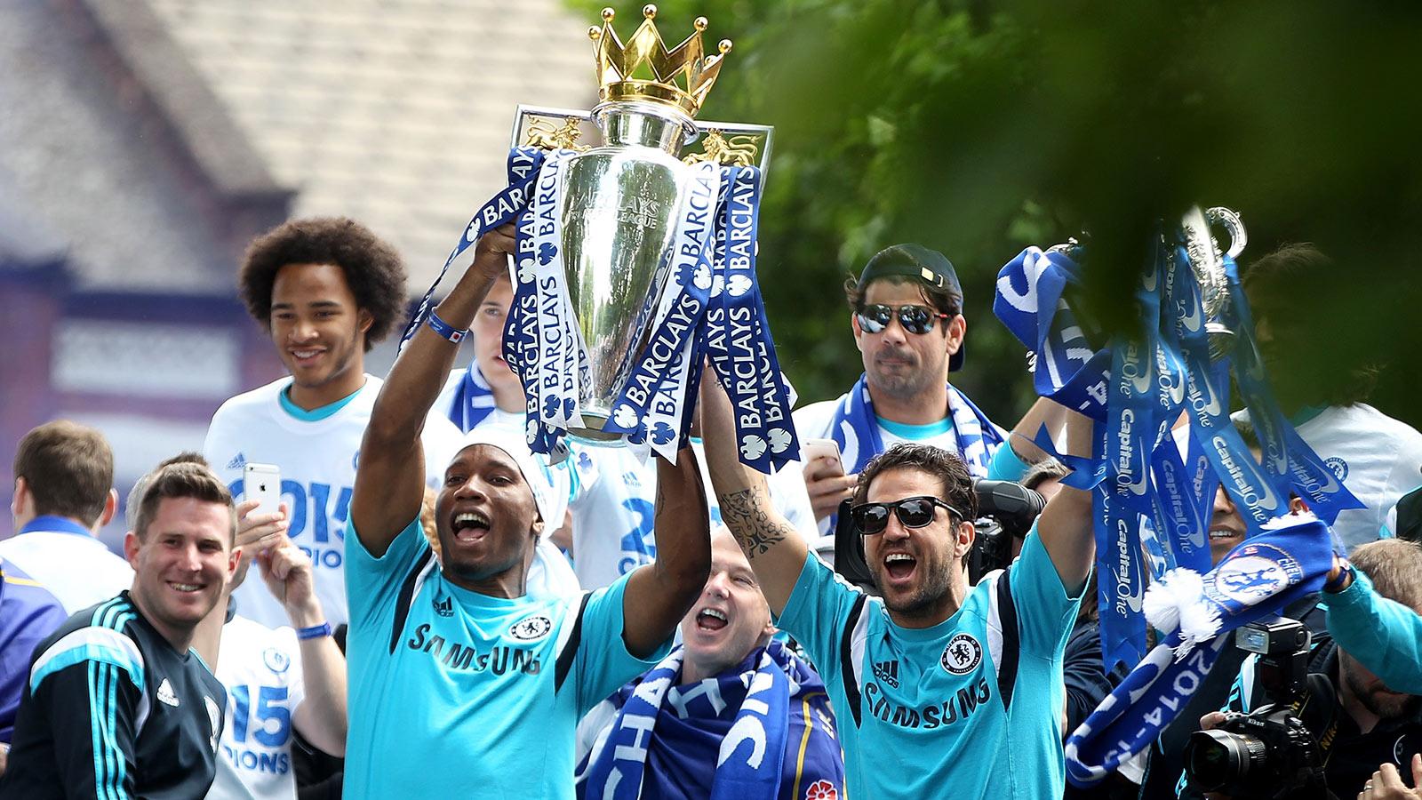 010616-SOCCER-Didier-Drogba-and-Cesc-Fabregas-of-Chelsea-celebrate-PI